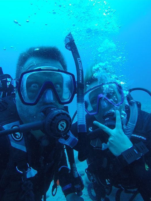 Steve Blum and Mary Elizabeth McGlynn scuba diving