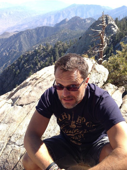 Steve Blum on a hike with mountain view background