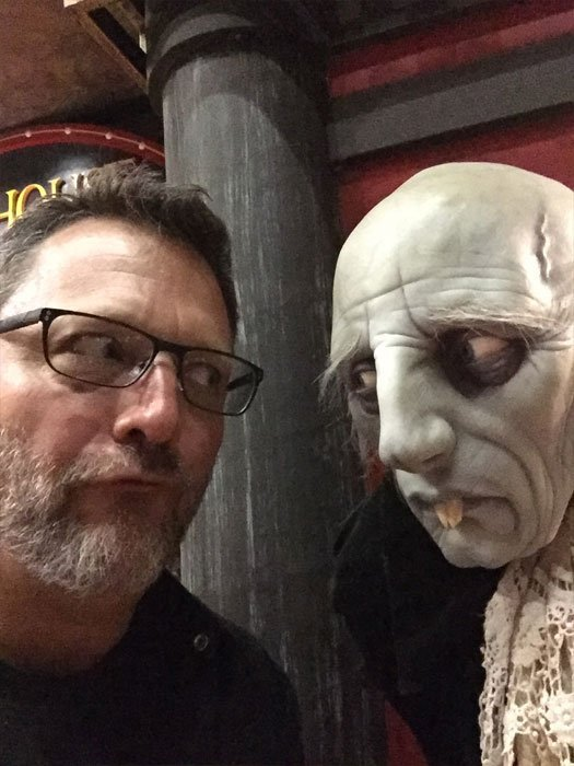 Steve Blum with creature statue at Sideshow Collectibles