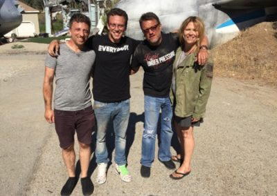 Brandon Blum, Logic, Steve Blum, and Mary Elizabeth McGlynn on the Take It Back set