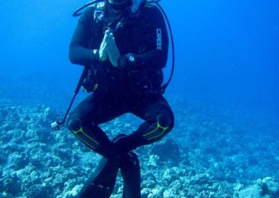 Steve Blum meditating underwater while scuba diving