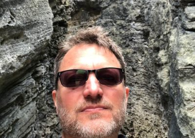 Steve Blum meditating surrounded by natural rock walls