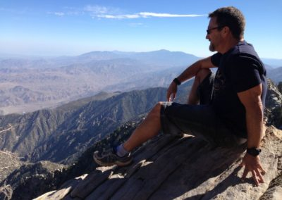 Steve Blum meditating on mountain above Palm Springs
