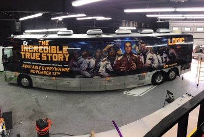 Bus with album cover for Logic's The Incredible True Story on the side