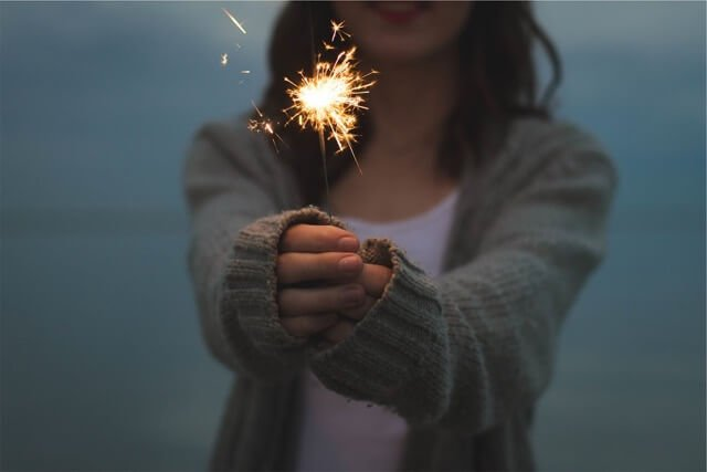 Girl Celebrating with Sparkler